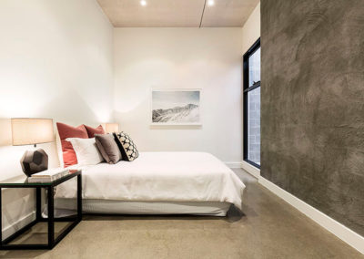 Modern Bedroom with Polished Concrete Floor