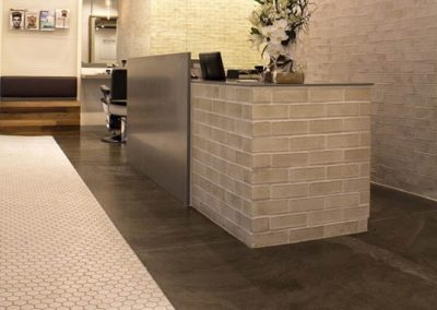 Polished concrete commercial flooring feather finish matte finish hair salon3